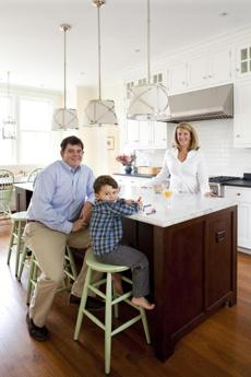 Ben and Angela Cavallo, pictured with their son, Sam, both had a say in the design of the powder room at their Dedham home. But Angela left the decisions about the layout, materials, and appliances in the kitchen to Ben, who loves to cook.